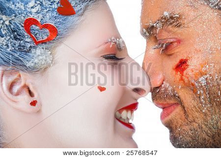 Close-up of happy make-up couple rubbing noses, faces covered with frost