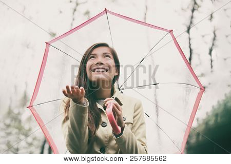 Autumn woman walking in rain