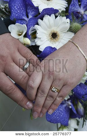 Wedding Rings And Bouquet Of Flowers