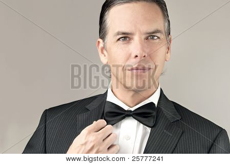 Confident Man In Tux Adjusts Cuff
