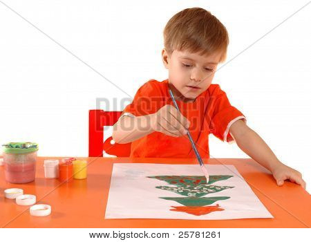 Child drawing a Christmas card