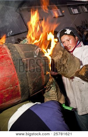 A Young Barrel Roller Is Left With Burning Gloves As She Exchanges The Barrel With Another Young Rol