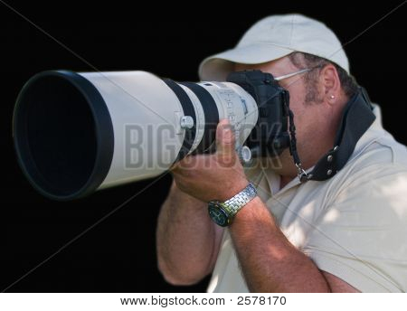 Man With Camera And Large White Lens