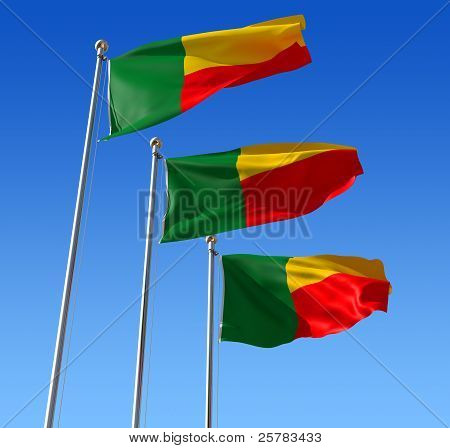 Three flags of Benin against blue sky.