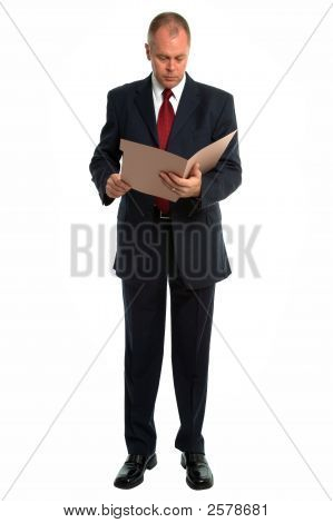 Businessman Reading A File