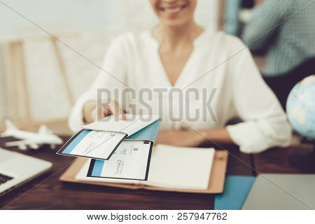 poster of Travel Agent Holding Tickets In Travel Agency. Smiling Woman In Office. Consultant In Travel Office.