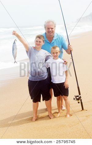 grandpa and two grandson catching a big fish on beach
