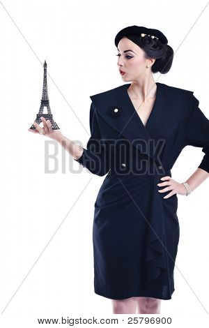 beautiful young woman hold paris symbol eiffel tower isolated on white background and representing travel and tourist concept