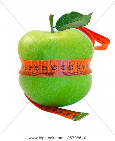 Close-up of an apple with a measuring tape around it isolated on white background