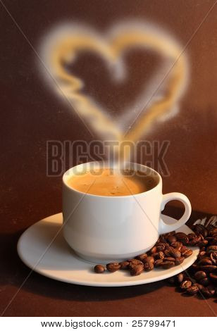 Cup of coffe with steam like heart on brown background