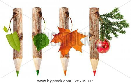 Wooden pencils with leaves isolated on white background. Four seasons: spring, summer, autumn, winter