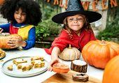 Kids in costume enjoying Halloween season poster