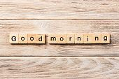 Good Morning Word Written On Wood Block. Good Morning Text On Table, Concept. poster