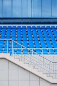 Empty Plastic Chairs In The Stands Of The Stadium. Many Empty Seats For Spectators In The Stands. Em poster