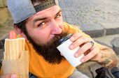 Tasty Sip Concept. Tasty Coffee Tea In Paper Cup Close Up. Man Bearded Hipster Enjoy Drink Paper Cup poster