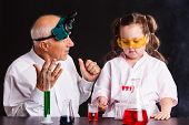 Interesting Chemical Experiments. Girl Doing A Chemical Experiment In Laboratory At School poster