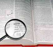 picture of verbs  - The word SEARCH in the dictionary under magnifying glass - JPG