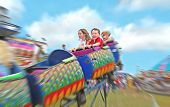 picture of amusement park rides  - Happy kids on rollercoaster at amusement park - JPG