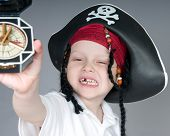 Young boy in pirate outfit