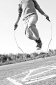 stock photo of hopscotch  - kid jumping rope on playground - JPG