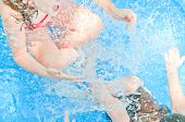 picture of swimming pool family  - Young kids having fun in pool - JPG