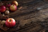 Autumn Red Apples With Cinnamon Sticks poster