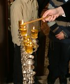 image of rabies  - Rabi lights a candle in the Jewish holiday of Hanukkah - JPG