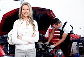 stock photo of auto repair shop  - Professional auto mechanic and woman in auto repair shop - JPG