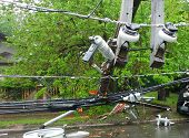 Storm Damaged Electric Transformer On A Pole And A Tree Damaged poster