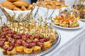 Food Snacks And Appetizers With Meat And Seafood On Table. Catering Banquet Table. Catering Party. C poster