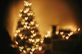 Christmas Abstract Background, Beautiful Christmas Tree Golden Lights Hearts Bokeh. Blur Of Yellow G poster
