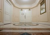 stock photo of anteroom  - Anteroom with white double door and mosaic marble floor - JPG