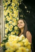 Cute Little Girl Smile With Yellow Rose Flowers. Smiling, Joy, Tenderness. poster