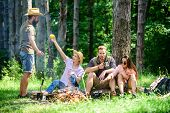 Camping And Hiking. Company Friends Relaxing And Having Snack Picnic Nature Background. Relax In Nat poster
