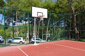 Basketball Hoop. Basketball Net. Basketball Court. Outdoor Basketball Hoop And Net In The Summer. poster