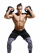 Young Bodybuilder Doing Sit Ups With Heavy Weight Kettlebells. Photo Of Muscular Man With Naked Tors poster