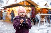 Little Cute Kid Girl With Cup Of Steaming Hot Chocolate Or Children Punch. Happy Child On Christmas  poster