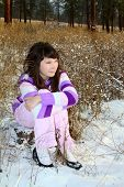 stock photo of american indian  - Young brunette teen in the field after the snowfall - JPG