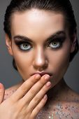 Shocked Glamorous Girl Posing With Makeup And Glitter On Body, Isolated On Grey poster