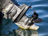 image of outboard  - outboard engine with propeller on the sea - JPG