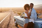 Portrait Of Romantic Couple Enjoying Road Trip In Classic Car poster