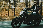 Motorcycle Biker Rides On Highway In A Forest.. Speed Vehicle. Cool Rider With A Leather Jacket. Mot poster