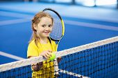 Child Playing Tennis On Indoor Court poster