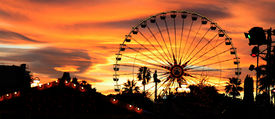image of carnival ride  - Panorama of a carnival silhouetted against the evening skyline at dusk - JPG