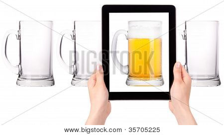 Empty And One Full Beer On Tablet Computer Screen