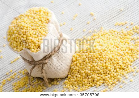 raw Millet in small sack