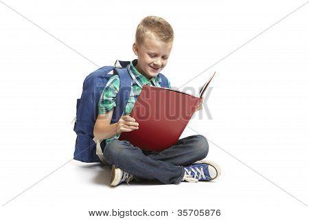 School Boy Sitting Reading
