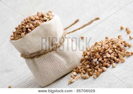 raw buckwheat in small sack