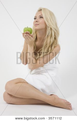 Young Female With Green Apple