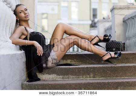 Woman Sitting On Ladder Steps